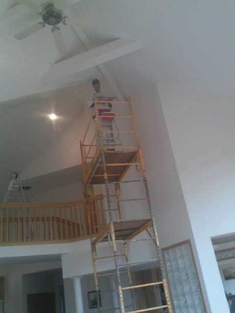 Here is Ray, working on scaffolding- the only option for repair and painting of this ceiling.
